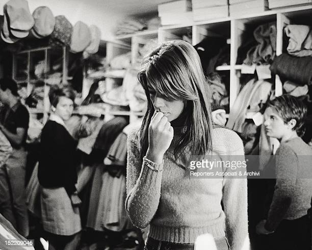 French singer and actress Francoise Hardy having a look about some dresses in a dress shop1960s