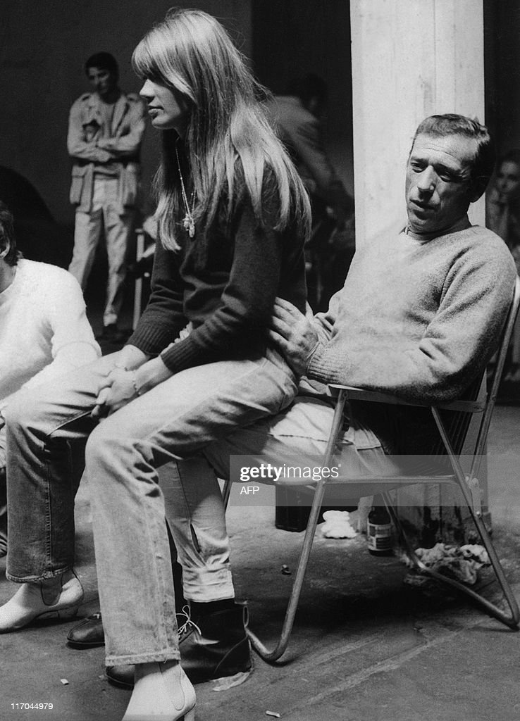 French singer and actress Francoise Hardy is sitting on the knee of French actor Yves Montand on the set of the movie 'Grand prix', directed by John Frankenheimer, in 1965.