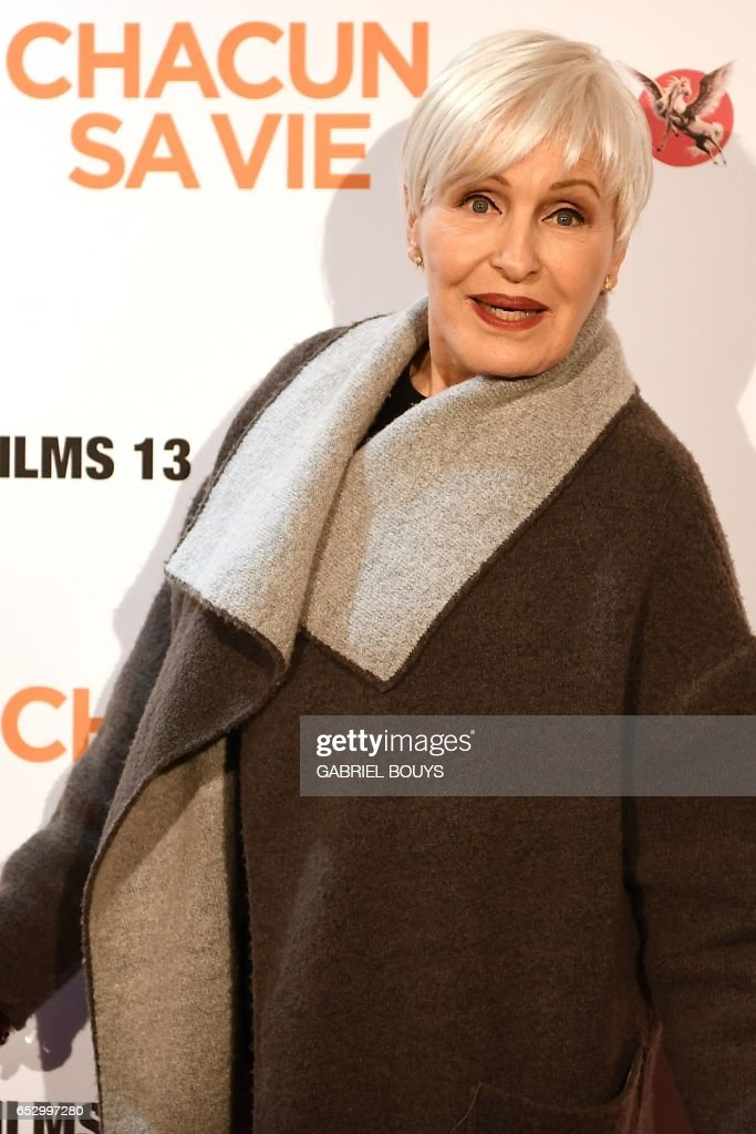 French singer and actress Nicole Croisille poses during the photocall for the premiere of the film 'Chacun Sa Vie' in Paris on March 13, 2017. The film is directed by French director Claude Lelouch. /