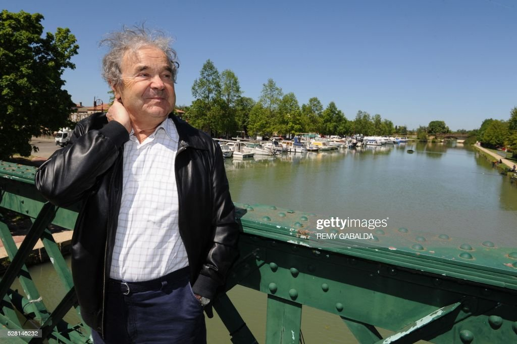 French singer and composer Pierre Perret walks along the Canal du Midi during the 'Alors Chante' music festival, on May 4, 2016, in his city of birth Castelsarrasin in the south west of France. GABALDA