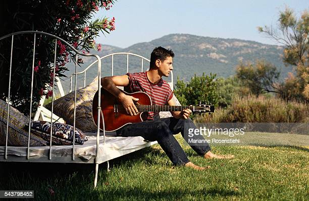 French singer and songwriter Etienne Daho plays a guitar