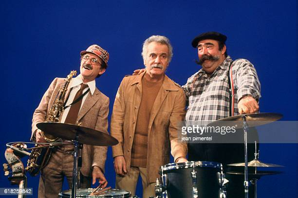 French singer and songwriter George Brassens with musicians Marcel Zanini and Moustache on the set of television show Show Brassens