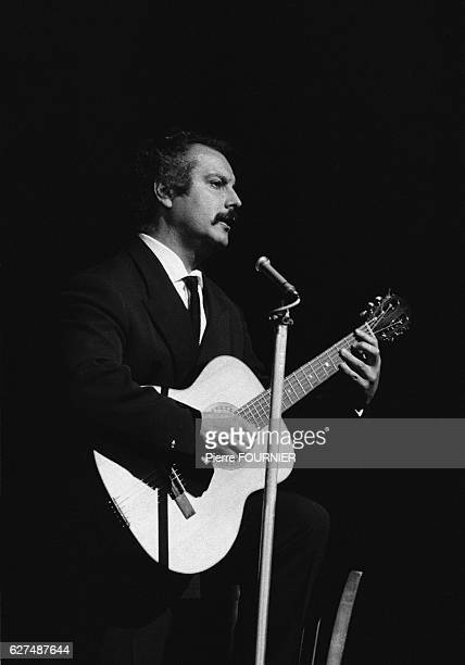 French singer and songwriter Georges Brassens on stage in Paris