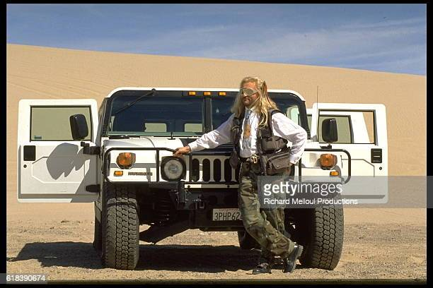 French singer and songwriter Michel Polnareff and his 4x4 Hummer during the filming of a TV show