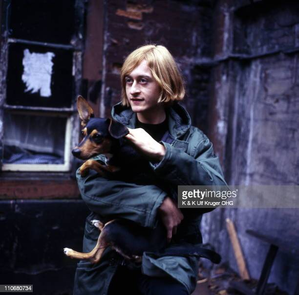 French Singer and songwriter Michel Polnareff posed holding a dog in a street in Hamburg Germany circa 1965 Photo Gunter Zint