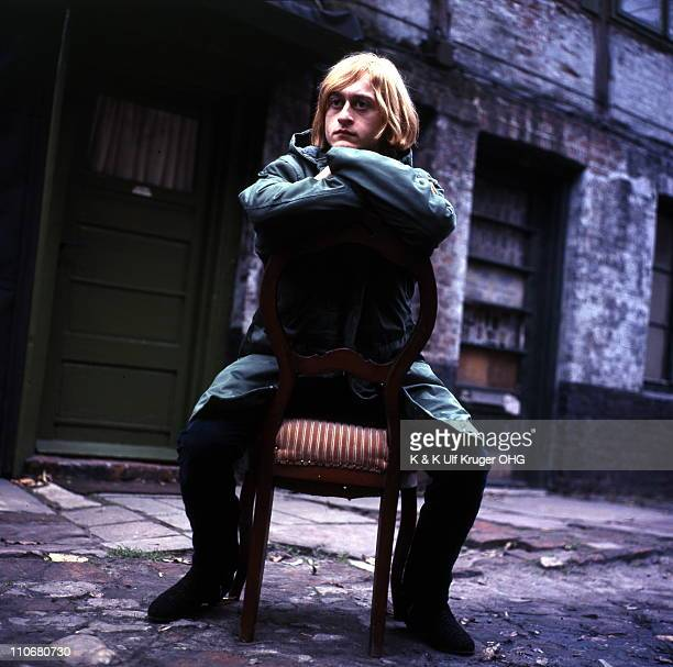 French Singer and songwriter Michel Polnareff posed sitting on a chair in a street in Hamburg Germany circa 1965 Photo Gunter Zint