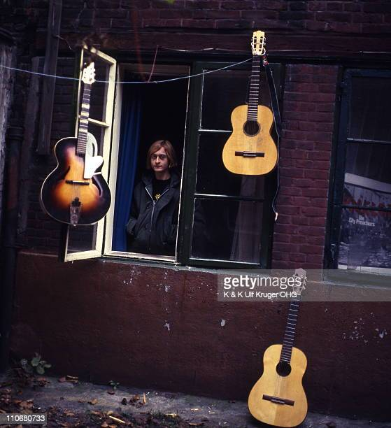 French Singer and songwriter Michel Polnareff posed standing at a window surrounded by guitars in a street in Hamburg Germany circa 1965 Photo Gunter...