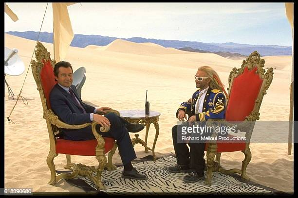 French singer and songwriter Michel Polnareff with TV host Michel Denisot during the filming of a TV show