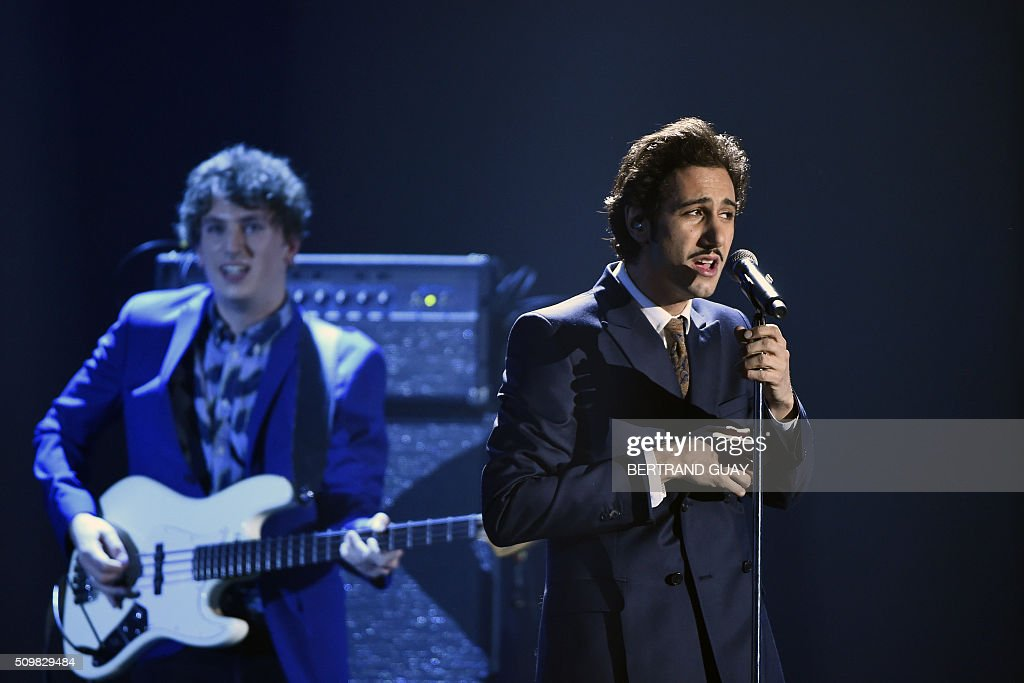 French singer Arthur (R) of French rock band Feu! Chatterton performs during the 31st Victoires de la Musique, the annual French music awards ceremony, on February 12, 2016 at the Zenith concert hall in Paris. AFP PHOTO / BERTRAND GUAY / AFP / BERTRAND GUAY