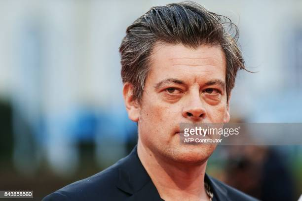 French singer Benjamin Biolay poses as he arrives for the screening of the movie 'Zookepper's wife' on September 7 2017 during the 43rd Deauville US...