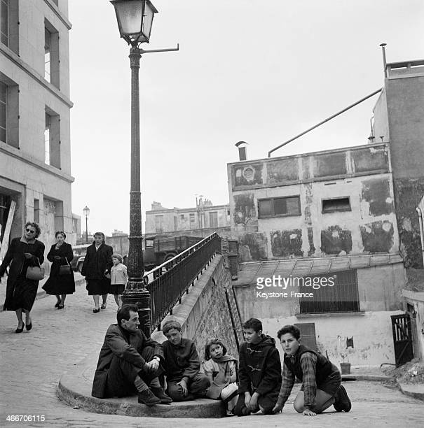 French singer Charles Aznavour pictured in the streets of Montmartre on April 12 1959