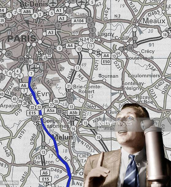 French singer Charles Trenet and roadmap of The Route nationale 7 from Paris to south of France