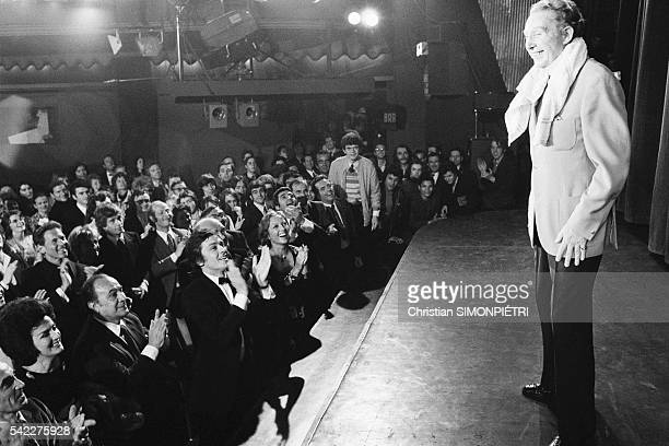 French singer Charles Trenet performs his first concert at Olympia Present in the first row are singer Tino Rossi and actor Alain Delon