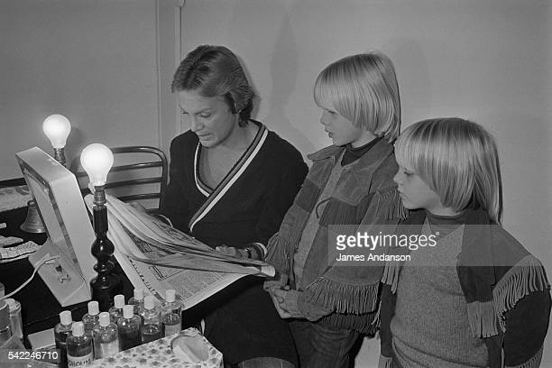French singer Claude Francois with his two sons Claude and Marc in his dressing room where he prepares for his first acting role in the film Droles...