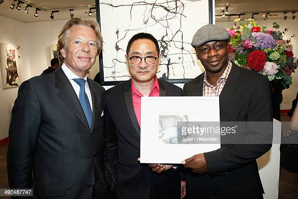 French singer Claude M'Barali aka MC Solaar Chinese artist Jiang Shanqing and President of Drouot Heritage Georges Delettrez attend the Jiang...