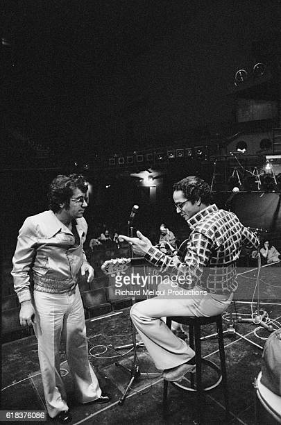 French singer Claude Nougaro talks with Brazilian jazz guitarist Baden Powell at the Olympia in Paris