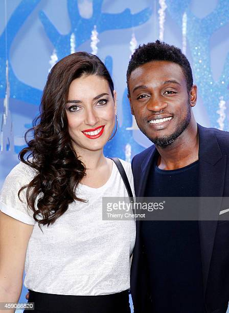 French singer Corneille and his wife attend the Christmas season launch at Disneyland Paris on November 15 2014 in Paris France