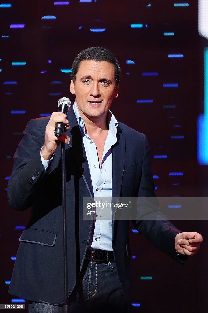 French singer Danny Brillant performs during the 26th Telethon, France's biggest annual fund-raising event during 30 hours of live television transmission, on December 8, 2012 in Saint-Denis, north of Paris. The event aims at collecting funds for research on genetic diseases such as myopathy, a neuromuscular disease. This year's edition raised 81,065,239 Euros. AFP PHOTO THOMAS SAMSON