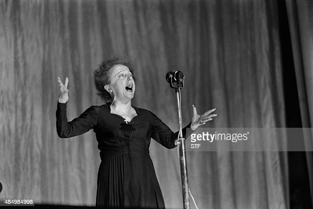 French singer Edith Piaf performs on stage at the Olympia concert hall in Paris on December 30 1960