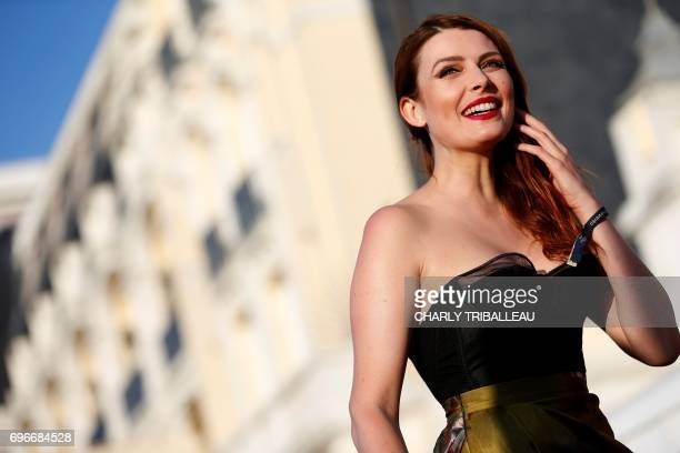 French singer Elodie Frege poses on the red carpet on June 16 2017 during the Cabourg Romantic Film Festival in Cabourg northwestern France / AFP...