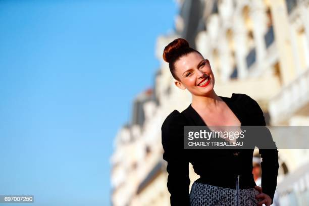 French singer Elodie Frege poses on the red carpet on June 17 2017 during the Cabourg Romantic Film Festival in Cabourg northwestern France / AFP...