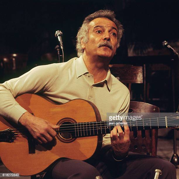 French Singer Georges Brassens Performs on Stage