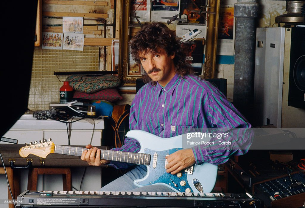 French singer Gerrard Blanc practices the electric guitar at home. He was formerly a member of the disco band 'Martin Circus.'
