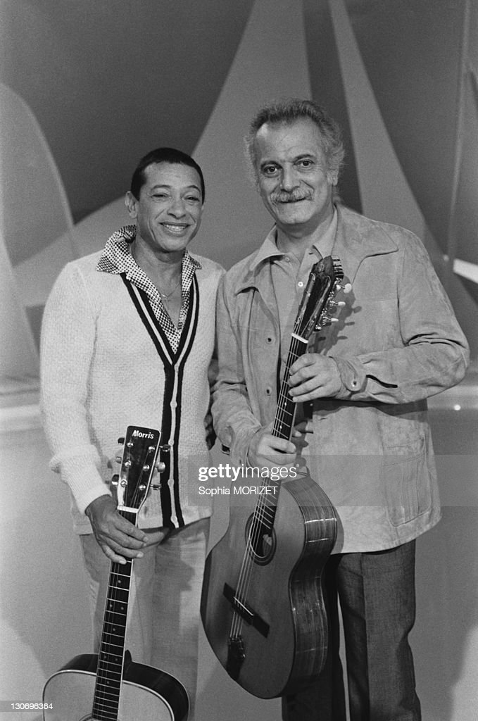 French singer Henri Salvador and French singersongwriter Georges Brassens on a TV show 'C'est L'Ete' during June 1978 in France