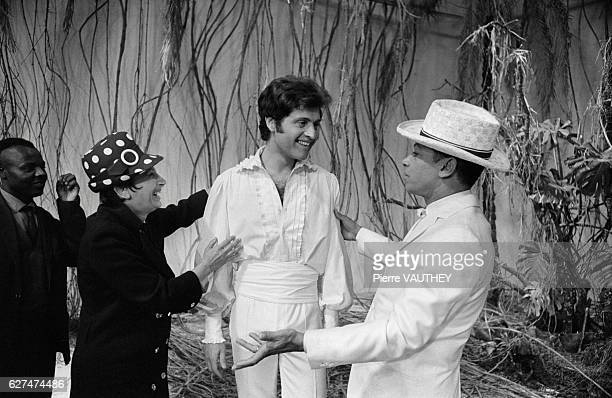 French singer Henri Salvador welcomes his guest Americanborn singer Joe Dassin on his television show Salve d'Or