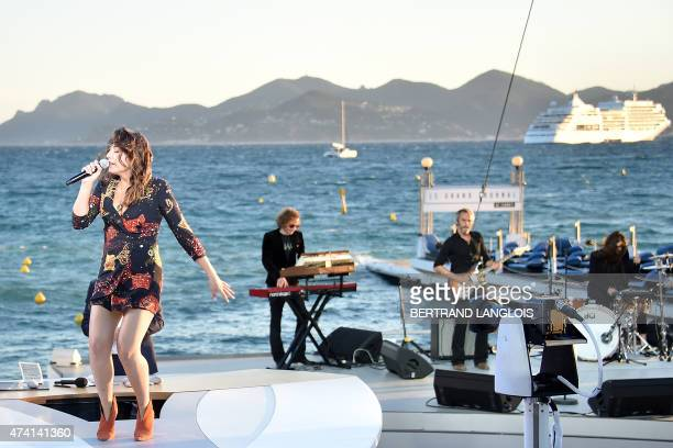 French singer Izia Higelin performs on the set of the Grand Journal TV show on the sidelines of the 68th Cannes Film Festival in Cannes southeastern...