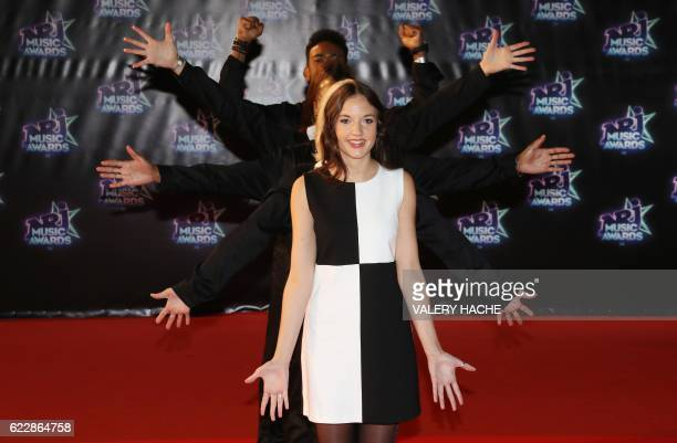 French singer Jain and dancers pose upon arrival at the Palais des Festivals to attend the 18th Annual NRJ Music Awards on November 12 2016 in Cannes...