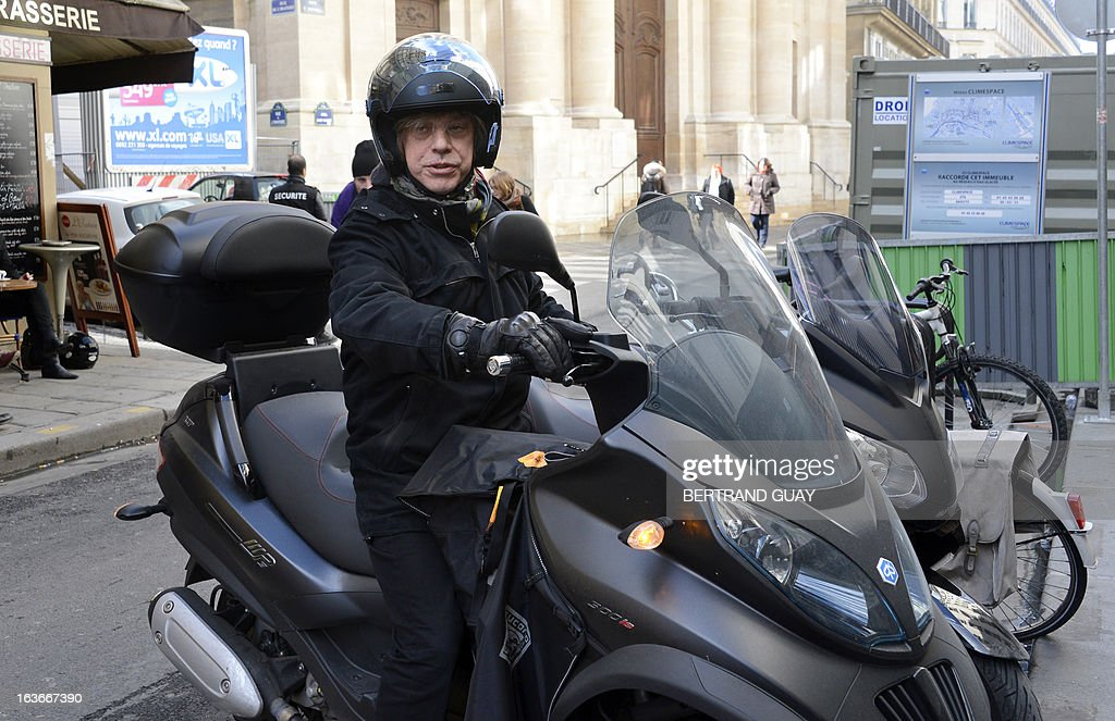 French singer Jean-Louis Aubert leaves on March 14, 2013 after the funeral ceremony for French singer Daniel Darc at the Protestant Temple de l'Oratoire in Paris. Darc, former singer of French band Taxi Girl, has died at the age of 53, on February 28.