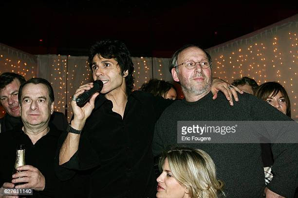 French singer JeanLuc Lahaye is surrounded by writers PaulLoup Sulitzer and Roger Knobelspiess at the Man Ray club in Paris