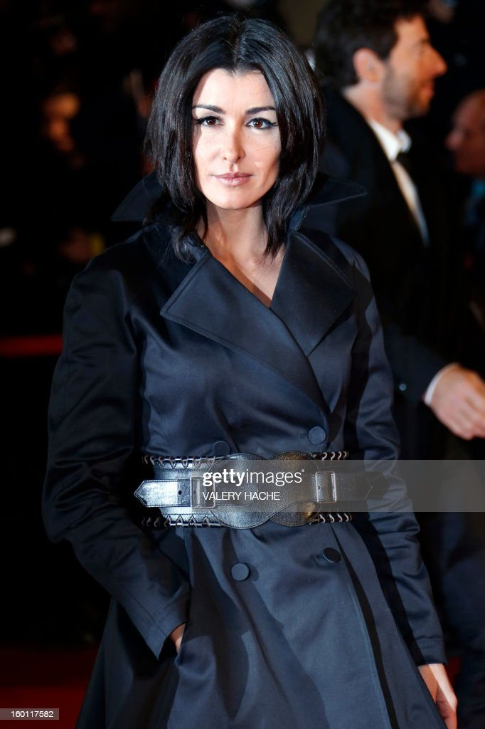 French singer Jenifer poses upon arrival at the Palais des Festivals during the 14th Annual NRJ Music Awards on January 26, 2013 in Cannes, southeastern France. News that the global music industry has finally turned the corner and is on the road to recovery should help get the annual four-day gathering of many of the world's top music execs at the MIDEM trade fair that opens here Saturday off to a good start. AFP PHOTO / VALERY HACHE