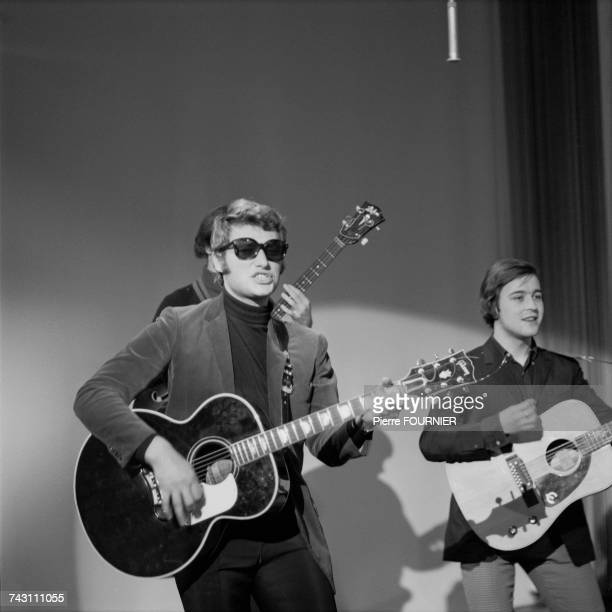French singer Johnny Hallyday performing on the TV show 'Sacha Show' circa 1965