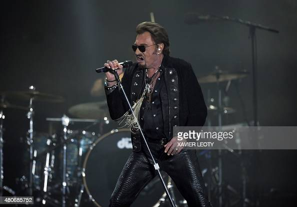 french singer johnny hallyday performs during the francofolies music festival in la rochelle on. Black Bedroom Furniture Sets. Home Design Ideas