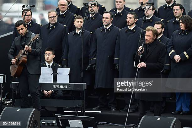 French singer Johnny Hallyday performs 'Un dimanche de Janvier' with French army choir and Musician Yodelice during The Tribute To 2015 Terrorist...