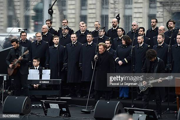 French singer Johnny Hallyday performs 'Un dimanche de Janvier' with French army choir Musicians Yodelice and Yarol Poupaud during The Tribute To...