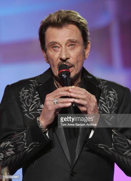 French singer Johnny Hallyday speaks on stage during the Les Victoires de la Musique at the Le Zenith on February 28 2009 in Paris France