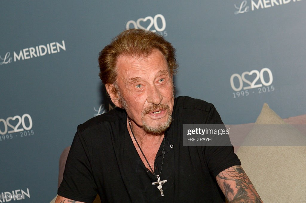 French singer Johnny Hallyday speaks to journalists in the Le Meridien hotel in Noumea on April 29 before his concert. / AFP / Fred Payet