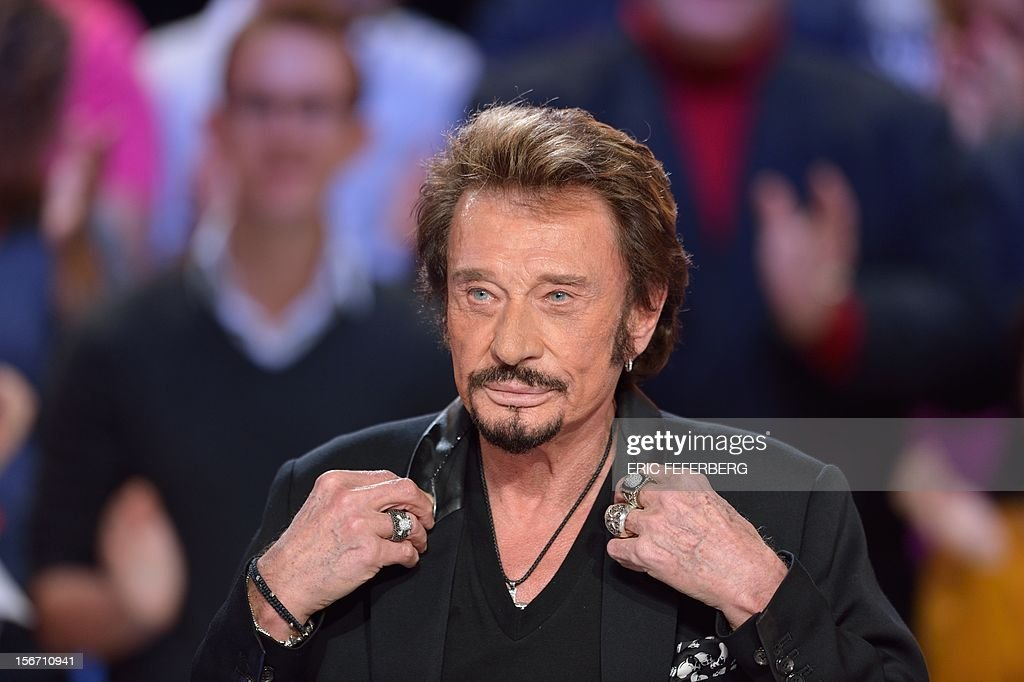 French singer Johnny Hallyday takes part in the TV show 'Le grand journal' on a set of French TV Canal+, on November 19, 2012 in Paris.