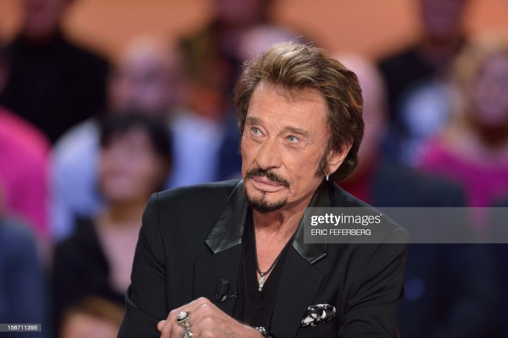 French singer Johnny Hallyday takes part in the TV show 'Le grand journal' on a set of French TV Canal+, on November 19, 2012 in Paris, to present his new album entitled, 'The wait'.