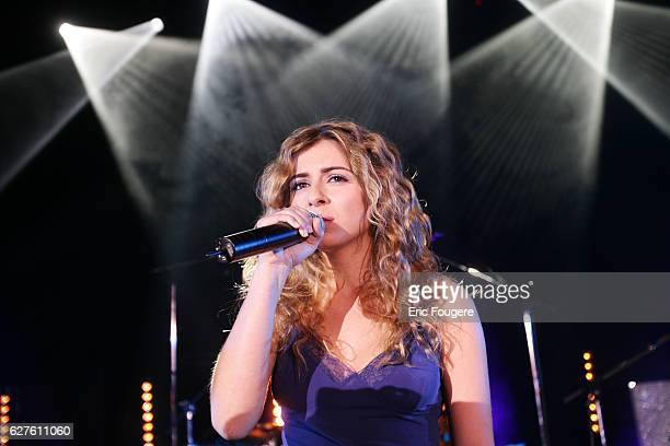 French singer Julie Zenatti performs on stage at the launching of the new TV channels 'M6 Music Rock' and 'M6 Music Black'