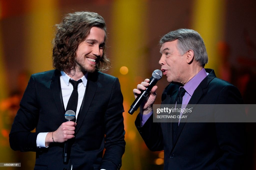 French singer Julien Dore and Belgian singer Salvatore Adamo perform during the 29th Victoires de la Musique, the annual French music awards ceremony, on February 14, 2014 at the Zenith concert hall in Paris.