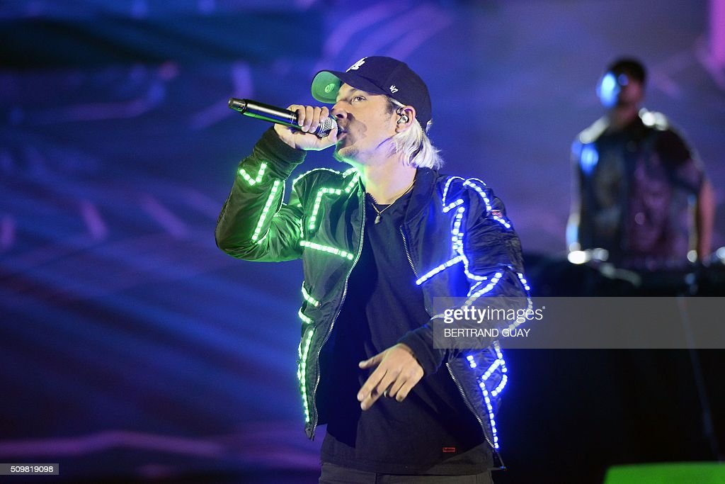 French singer Ken Samaras aka Nekfeu performs on stage during the 31st Victoires de la Musique, the annual French music awards ceremony, on February 12, 2016 at the Zenith concert hall in Paris. AFP PHOTO / BERTRAND GUAY / AFP / BERTRAND GUAY