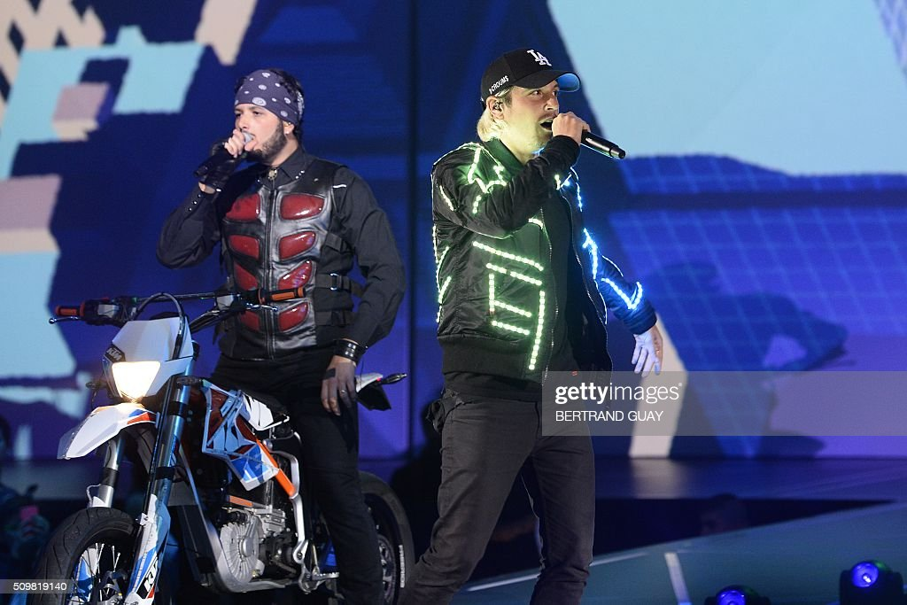 French singer Ken Samaras aka Nekfeu (R) performs on stage during the 31st Victoires de la Musique, the annual French music awards ceremony, on February 12, 2016 at the Zenith concert hall in Paris. AFP PHOTO / BERTRAND GUAY / AFP / BERTRAND GUAY