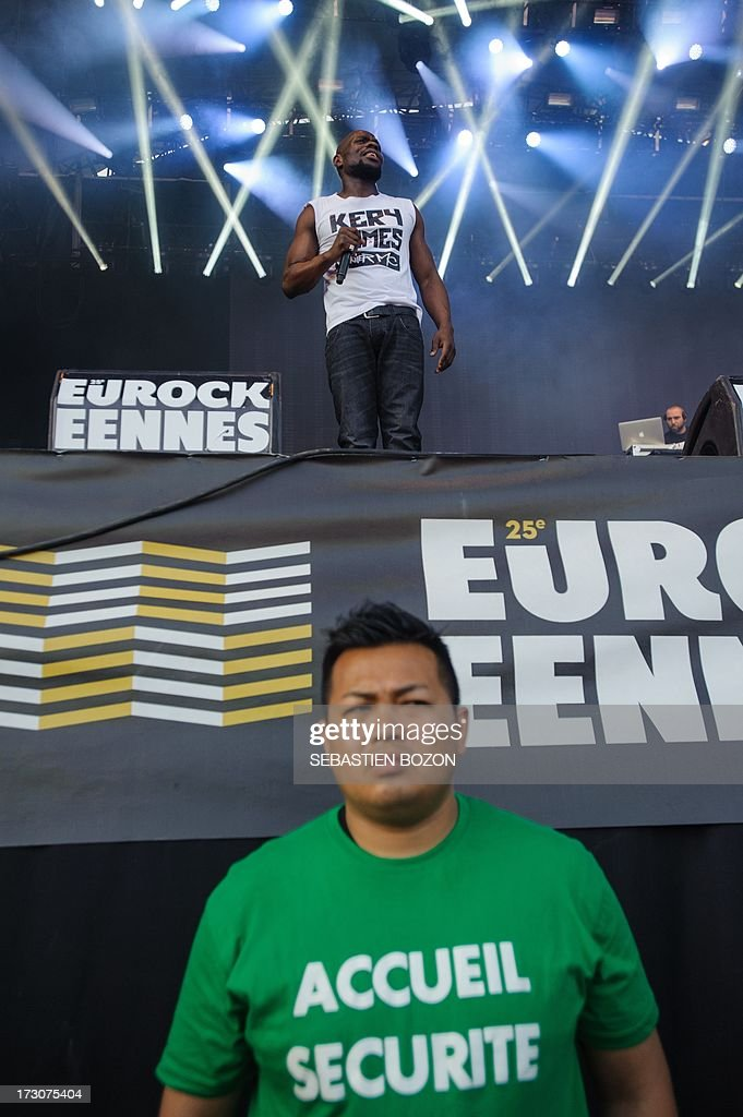 French singer Kery James (up) performs on stage of the Eurockeennes music festival on July 6, 2013, in the French eastern city of Belfort.