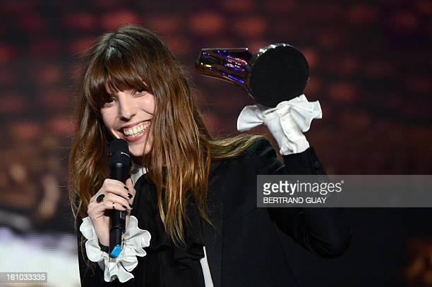 French singer Lou Doillon holds her trophy after receiving the women's artist of the year award during the 28th Victoires de la Musique the annual...