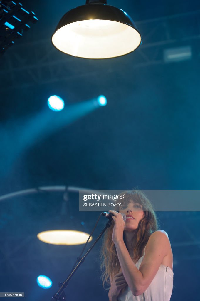 French singer Lou Doillon performs on the stage of the Eurockeennes music festival on July 6, 2013, in the French eastern city of Belfort. AFP PHOTO / SEBASTIEN BOZON