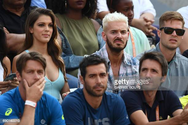 French singer M Pokora and Miss Univers French Iris Mittenaere attend a tennis match at the Roland Garros 2017 French Open on May 30 2017 in Paris /...